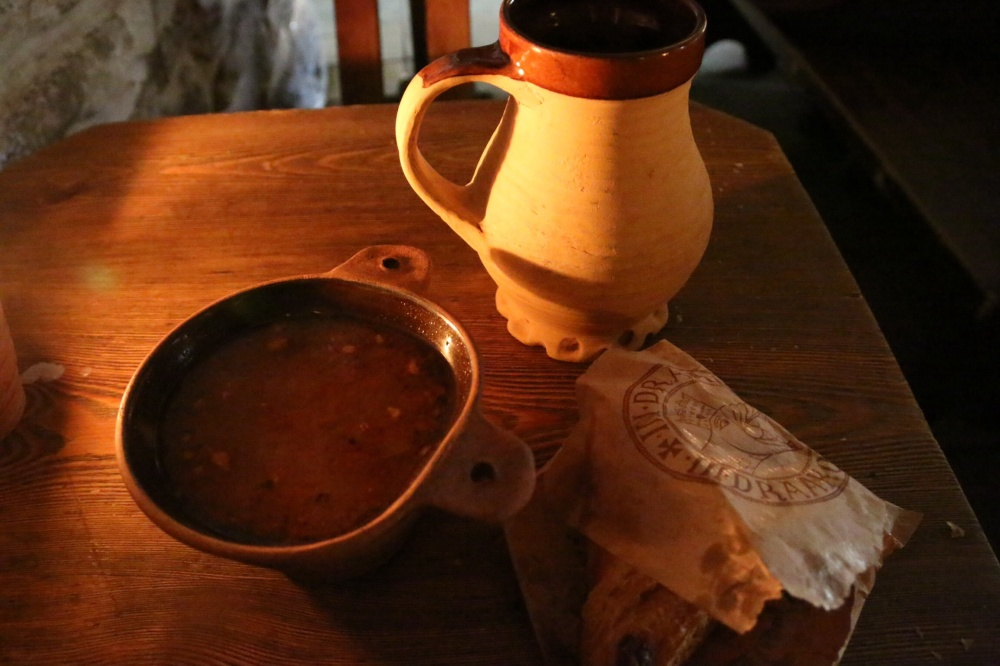 Elk soup, fresh bread, and a flagon of dark ale